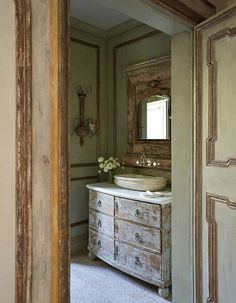 Provence house. If we ever switch out the vanity in brendan's bathroom, I would like to finish the walls similar to that and convert a dresser to a vanity with raised vessel sinks like that.