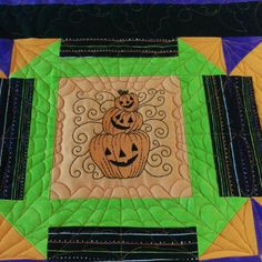 Cute embroideries and custom designed spider webs for Halloween quilt.