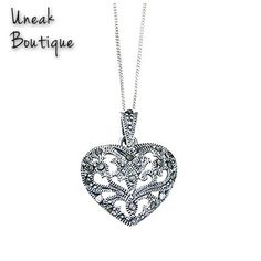 Silver Hollow Heart Marcasite Pendant with a heart shaped scrolling design. Beautiful marcasite jewels and intricate etching and beading adorn this lovely sterling silver marcasite pendant which comes with a sterling silver 16 inch curb chain. Only £25.99!