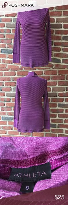 "Athleta Turtleneck Top Purple Stripe Small Brand: Athleta Size:  Small Color:  Purple Style/Specifics:  Turtleneck Top - Ridged Texture - Long Sleeves    ALL MEASUREMENTS ARE APPROXIMATE AND TAKEN WITH GARMENT LAYING FLAT  Armpit to Armpit 16"" Bottom of Hem from Hip to Hip 17"" Length 26"" Sleeves 25"" Athleta Tops Tunics"
