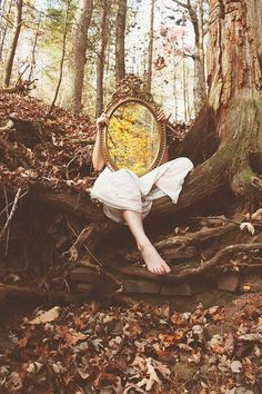 Surreal mirror photography shot of a female model in an overgrown field, holding a mirror over her ace which reflects more overgrown foliage Mirror Photography, Fantasy Photography, Creative Photography, Portrait Photography, Photography Contests, Adobe Photography, Photography Timeline, Capture Photography, Photography Hacks