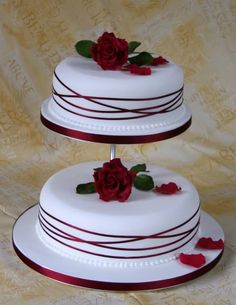 2 Tier Single Rose Wedding Cake...I prefer this style over a layered cake...just with cala lilies instead of roses