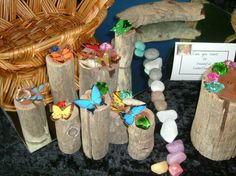 Butterflies on logs - reggio-inspired. This is from my pre-primary class, the children love the logs and other loose bits.