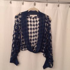 Bette Paige teal crochet shrug Boho chic crochet teal shrug by Bette Paige. Item is in excellent condition because it has only been worn once. Please email me if you have any questions Bette Paige Sweaters Shrugs & Ponchos