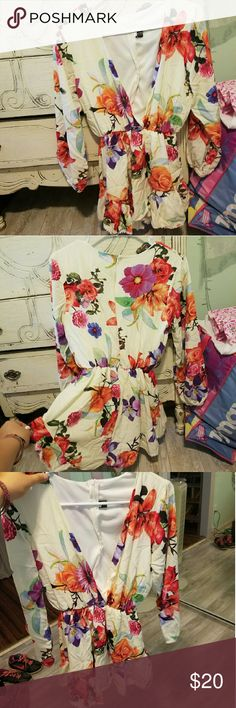 Long sleeve romper This romper is absolutely adorable! It has a colorful floral pattern and long sleeves. It has never been worn. Other