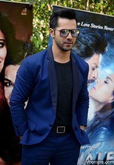 Varun Dhawan looks hot in a blue suit, grey T-shirt and rectangle sunglasses. via Voompla.com