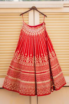Beautiful red gotapatti lehenga for the wedding day | WedMeGood| #wedmegood #indianweddings #lehenga #bridallehenga #gotapatti #goldwork #red