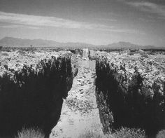 Michael Heizer, Double Negative, 1969  Mormon Mesa, Nevada  Double Negative is Michael Heizer's first prominent earthwork. Seen above from near the edge of the work, and below from space via satellite, Double Negative consists of two trenches cut into the eastern edge of the Mormon Mesa, northwest of Overton, Nevada in 1969-70.  The trenches line up across a large gap formed by the natural shape of the mesa edge.