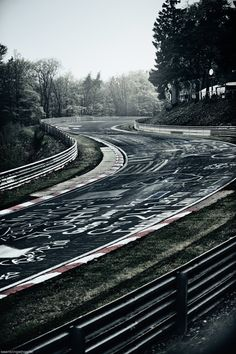 "Nordschleife. Also referred to as ""the green hell"" the worst most greuling racetrack thats is responsible for multiple deaths a year. ironic that they allow people to graffiti it? I dont think so. Those kooky germans"