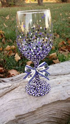 Baltimore Ravens inspired wine glass with purple/black/white dot accents and… Decorated Wine Glasses, Hand Painted Wine Glasses, Wine Painting, Bottle Painting, Wine Glass Crafts, Wine Bottle Crafts, Wine Bottle Glasses, Diy Glasses, Wine Glass Designs