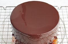 """Gelatin is the key to a glistening chocolate glaze that stays put on your cake. Jacques Torres prepared this recipe with Martha on Episode 501 of """"Martha Bakes. Shiny Chocolate Glaze Recipe, Sour Cream Chocolate Cake, Chocolate Ganache, Cake Design For Men, Hungarian Cake, Mirror Glaze Cake, Mirror Cakes, Diet Cake, Torte Cake"""