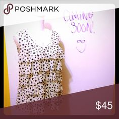 """🆕 LOFT Print Ruffle Top Sleeveless, partially lined and lightweight ruffle blouse; off white with watercolor ink-splatter print; ruffles are seamless and frayed to give this blouse an overall Artistic look  APPROX MEASUREMENTS •L: 25.5""""    •B: 19""""   •W: 20""""  🎀NWOT ❌No Trades 🛍Lower the price by bundling! LOFT Tops Blouses"""