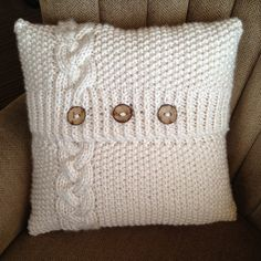Cable knit pillow with buttons