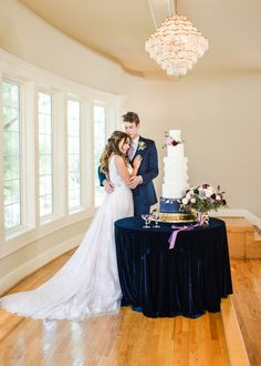 Gorgeous jewel tone wedding with a deep navy velvet table cloth, gold cake stand and blue wedding cake with purple accents! Photographed by Sarah Rieth Photography at Hawthorne House, a top wedding venue near Kansas City! Purple Wedding Cakes, Blue Wedding, Hawthorne House, Gold Cake Stand, Jewel Tone Wedding, Purple Accents, Kansas City, Wedding Venues, Reception