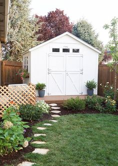 Shed Reveal Stepping stones and landscaping around the shed. Build a smallish porch on front of our shed.Stepping stones and landscaping around the shed. Build a smallish porch on front of our shed. Backyard Storage Sheds, Backyard Sheds, Outdoor Sheds, Backyard Retreat, Shed Storage, Storage Shed Landscaping Ideas, Diy Storage, Garden Sheds, Shed Makeover