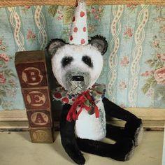 Antique, prim style, Panda teddy bear available from Brady Bears Studio.