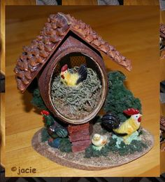 Made from a real Emu Egg and pine cone shells for the roof. Wood base with porcelain figures. Stands apx. 8 tall. All of my eggs are one of a kind.  NO SHIPPING COST