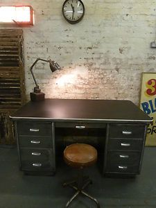 A vintage metal desk would go perfectly with our garage theme for the basement!