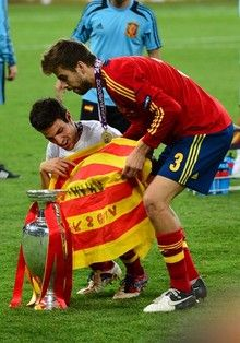 Spanish midfielder Cesc Fabregas (L) and defender Gerard Pique celebrate after winning the Euro 2012 football championships final match Spain vs Italy on July 1, 2012 at the Olympic Stadium in Kiev.