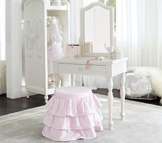 A DIY tutorial to build a kids play vanity set. Make this kid sized play vanity set with a drawer, mirror and cute little stool. Free plans for you.