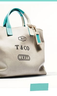 A tote bag from Tiffany is ideal for the jet-setter on your list. Tiffany And Co, Tiffany Blue, Weekender Tote, Tiffany Jewelry, Summer Bags, Luxury Bags, Fashion Bags, Fashion Outfits, Luggage Bags