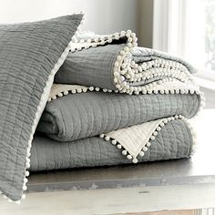 Ballard Designs Audree Pom Pom Quilt bedding - Gray Item: FL872GRY | http://www.ballarddesigns.com/audree-pom-pom-quilt-bedding-gray/294714