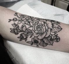 Floral woodcut tattoo by Jennifer Lawes
