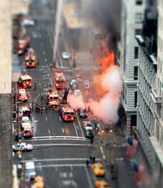 Tilt shift photography  A giant could be quite helpful when it comes to a fire, because they could get more water but also maybe blow out the flames