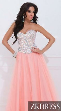"""Long Coral Bling Prom Dress!  """"Trendy, Unique and Affordable"""" - That is the main philosophy at Bling Boutique in Milford, MI!  Stop by our store to find some fashionable items that will spice up your wardrobe!  Visit www.downtownbling.com or call (248)  685-8449 for more information!"""