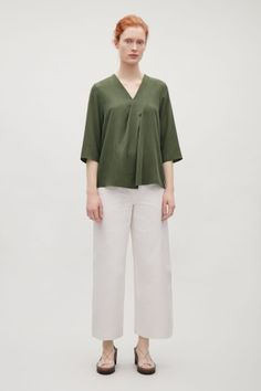 COS image 1 of V-neck top with front pleats in Bottle Green