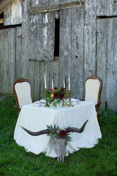 Southwestern inspired sweetheart table: http://www.stylemepretty.com/california-weddings/marin/2015/05/30/bohemian-ranch-wedding-inspiration/ | Photography: Dustin Cantrell - http://www.dustincantrellphotoblog.com/