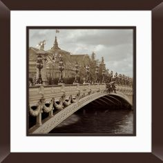 Framed photographic print showcasing a Parisian scene.    Product: Framed photography   Construction Material: Poys...