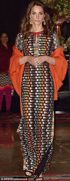 She paired it with a £275 pashmina from Pickett London and Gianvito Rossi sandals...