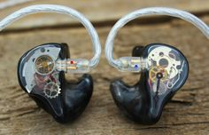 In ear monitors with watch components