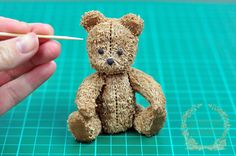 Creating fur on an antique teddy bear from modeling chocolate by Juniper Cakery