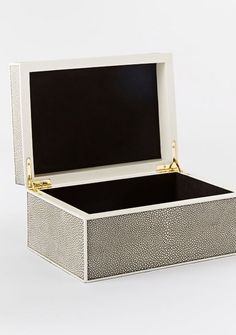 Place this chic box on an accent table or dresser to stylishly stow your trinkets. Faux Shagreen Box, West Elm, $79