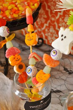 Halloween Candy Kabobs. Cute desert table decoration. You can also put out the candy in bowls and let party guests make their own.