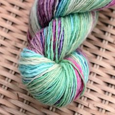 This sport weight singles yarn is spun from 65% merino wool and 35% Sparkle Nylon. The batt was hand-dyed by Frabjous Fibers in pastel shades. The yarn will make long gradient stripes in a pastel rainbow with shades of cream, baby pink, sky blue, mint green, and lavender. This skein has 320yds...
