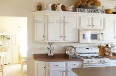 Gorgeous kitchen! http://debbie-debbiedoos.com/2013/04/farmhouse-shabby-romantic-style-home-tour.html