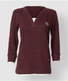 Keep warm in the fall and winter with this styled maroon thermal. Made of soft yet warm waffled cotton this deep v neck henly features details that make it look layered without addeding thickness. There is an embroidered block ATM on the front of the shirt.