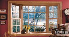 Bay window with double-hung end vents, colonial grids, woodgrain interior finish and an oak veneer shell. Learn more.