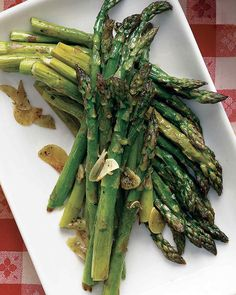 Olive oil and garlic adds extra flavor to roasted asparagus.