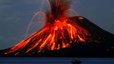 Krakatau volcano: Fishermen sail in front of Anak Krakatau as it erupts in June 2009