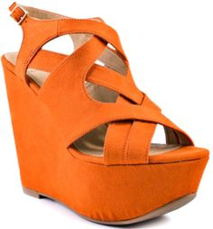 Weave an eye catching statement in this Kelsi Dagger sandal. Nadeen gives you a vibrant hue of orange suede and memzorizing crossed straps. This style also features a 5 inch wedge and 1 inch thick platform.