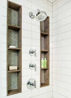 White shower tile with grey penny round tiles and wood tile shower shelf