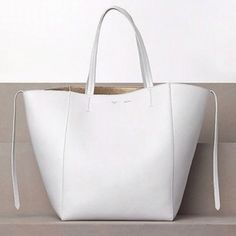 $1,200, Celine White Drummed Calfskin Leather Cabas Phantom Tote Bag, at Yoogi's…