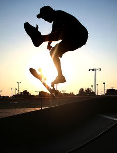 Silhouetted skateboarder