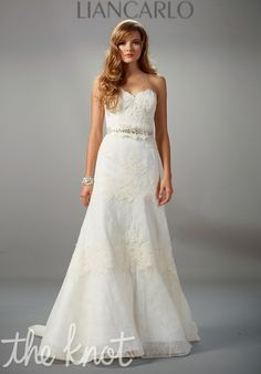 Gown features lace. Beaded belt also available.