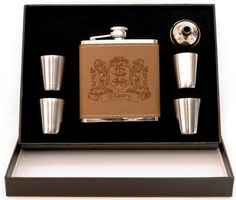 Stainless steel flask wrapped in a soft textured leather with edge stitching. Holds 6 ounces with laser engraved coat of arms design. Four 1 ounce stainless steel cups and one pouring funnel. Enclosed in a black presentation box for easy wrapping. Choose from over 900 available Irish family coat of arms just call the store for your request. - See more at: http://www.irishongrand.com/gifts/family-crests/sexton/irish-family-crest-flask-set-pid-24234#sthash.LlZ98iXJ.dpuf
