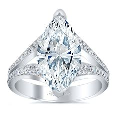 This Split Shank Pave Diamond Marquise Engagement Ring uses pave diamonds like a runway of sparkle to highlight and lead the gaze of onlookers to the center stone.